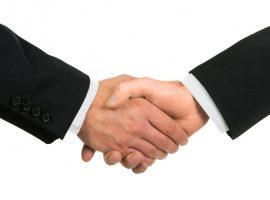 depositphotos_12296407-stock-photo-businessmen-shaking-hands-isolated-on